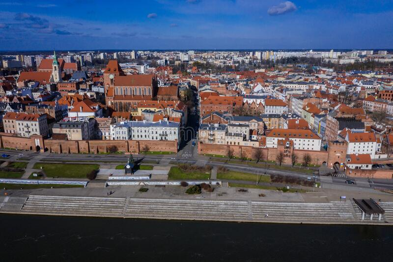 Torun city in Poland. Drone view of historic part of Torun city over Vistula River in Poland with St John the Baptist Cathedral and Church of Holy Spirit, old royalty free stock photography