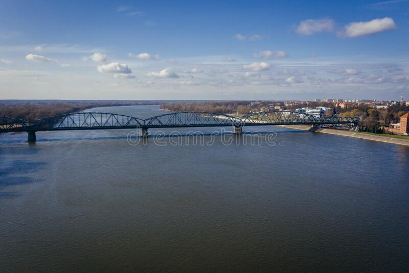 Torun city in Poland. Drone view on the River Vistula and Jozef Pilsudski bridge in Torun city in Poland, photography, aerial, above, point, high, angle, polish stock photo