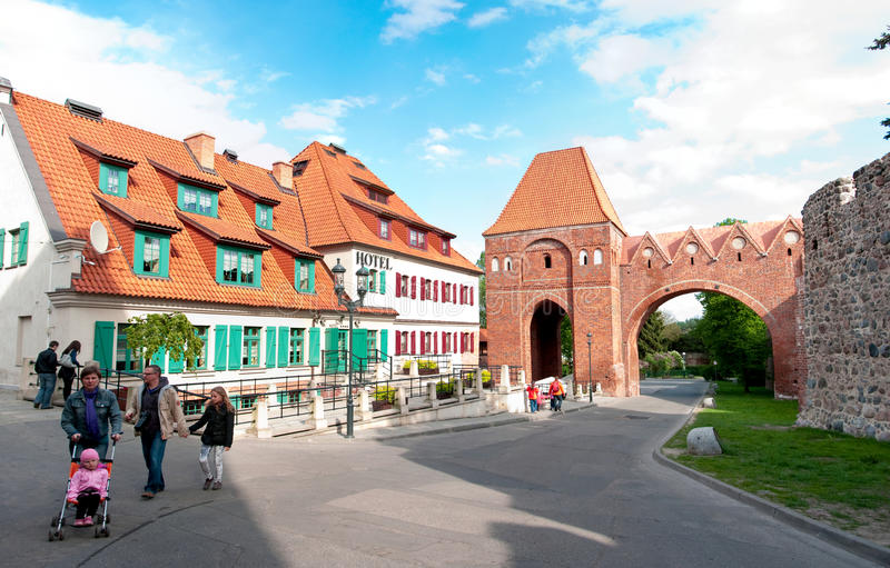 Torun, Poland. Teutonic Knights Castle with old style hotel. Tourists doing sightseeing royalty free stock photos