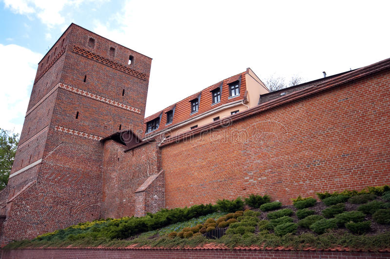 Torun, Poland - the Leaning Tower. Famous landmark of Torun, Poland - The Leaning Tower (Krzywa Wieza) with fortification wall stock image