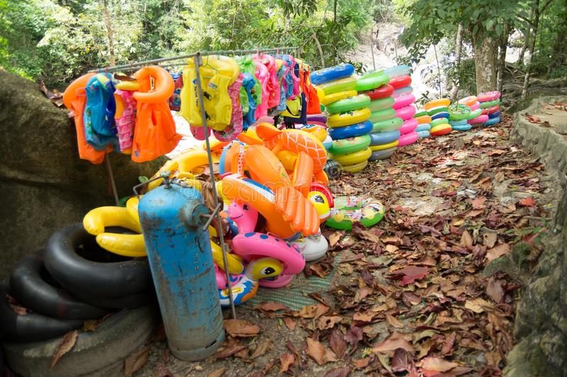 Torus and life vest. Available near the waterfall for swimming stock photos