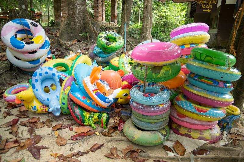 Torus and life vest. Available near the waterfall for swimming stock image