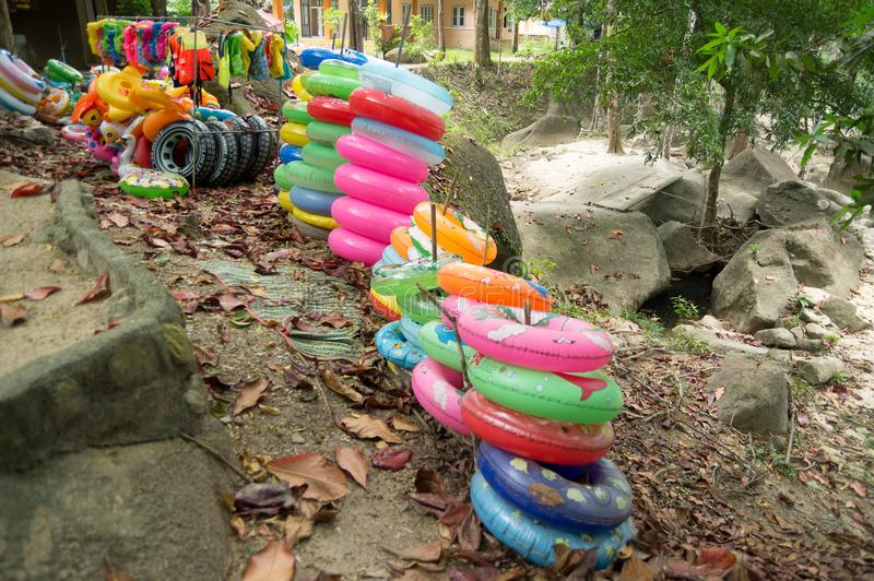 Torus and life vest. Available near the waterfall for swimming royalty free stock photos