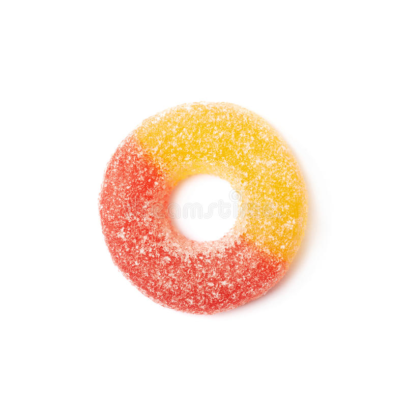 Torus shaped gelatin candy isolated. Torus shaped gelatin based sour sweet red and yellow colored chewing candy isolated over the white background stock photo