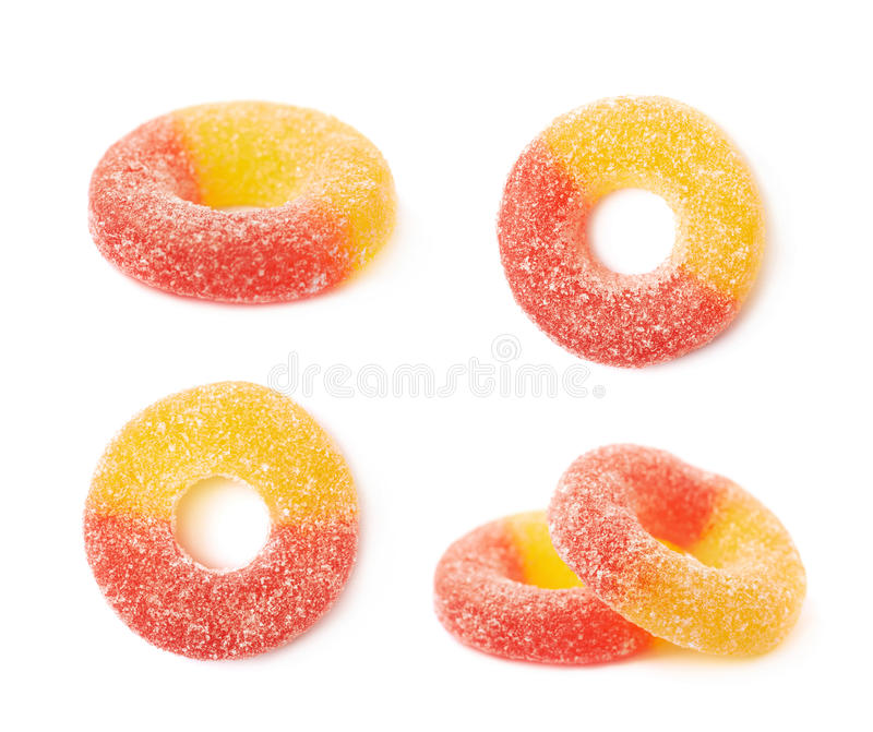 Torus shaped gelatin candy isolated. Torus shaped gelatin based sour sweet red and yellow colored chewing candy isolated over the white background, set of four royalty free stock image