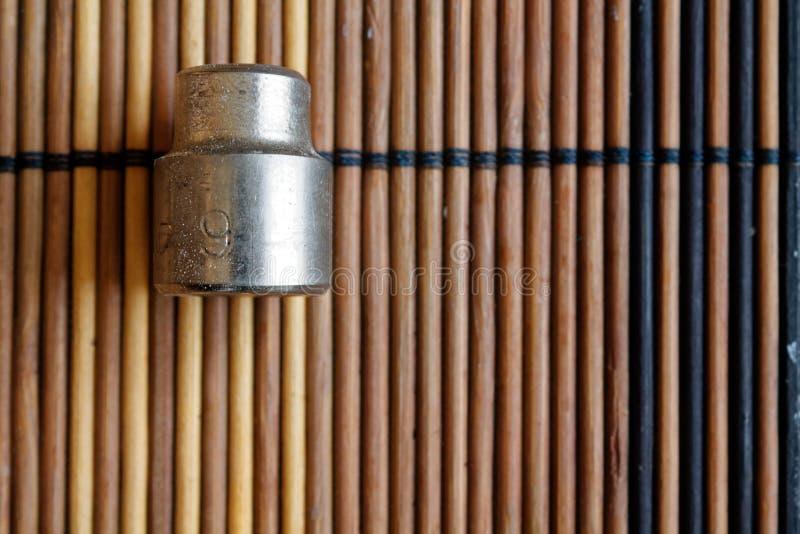 Torx nasadka dla spanner na drewnianym tle, wyrwanie nasadek rozmiar jest 9 obraz stock