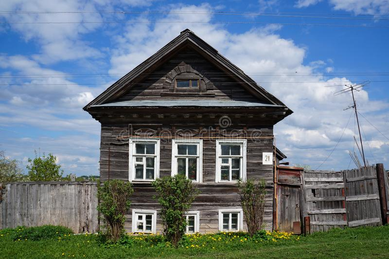 Old wooden house with traditional decorative elements on the facade stock image