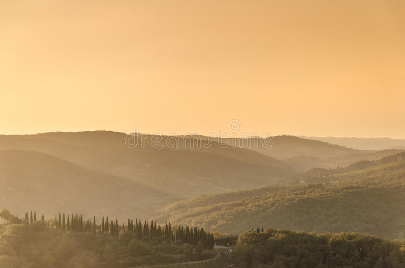 Toskańscy wzgórza przy zmierzchem obrazy royalty free