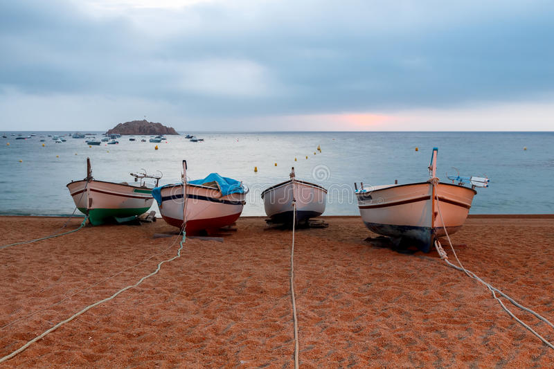 Tossa de Mar. Fishing boats on the beach stock photography