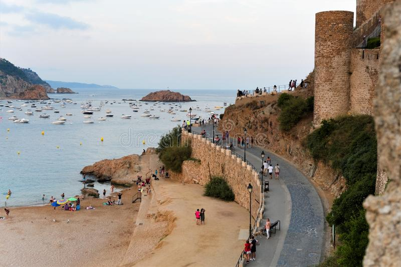 Tossa de Mar, Spain, August 2018. The road at the medieval tower at sunset. royalty free stock image
