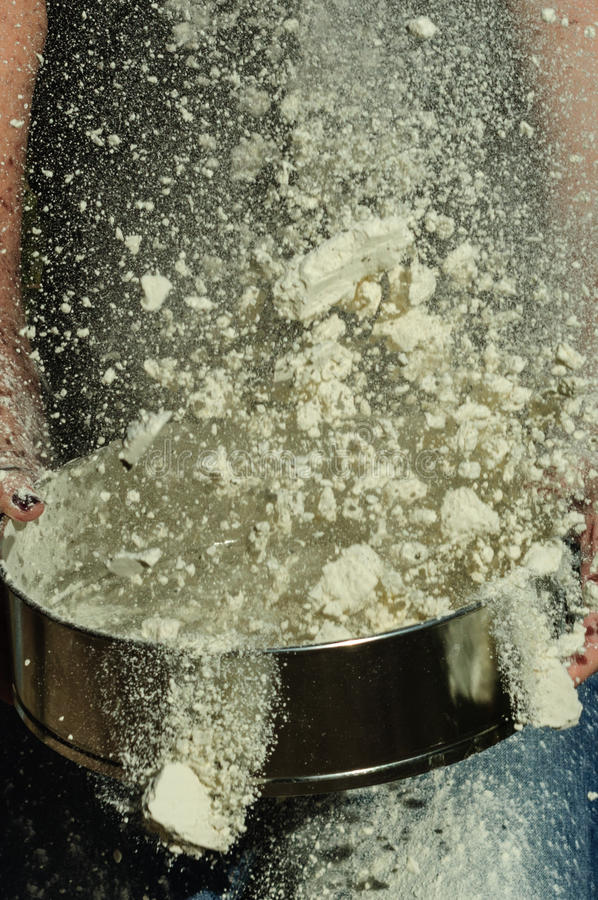 The tossed flour. The flour tossed in the air royalty free stock image