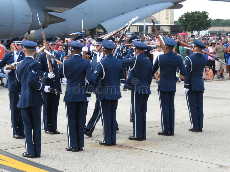 Tossing Rifles. Photo of military drill team tossing rifles with bayonets at andrews air force base in maryland during an air show on 9/16/17. These soldiers are royalty free stock photography