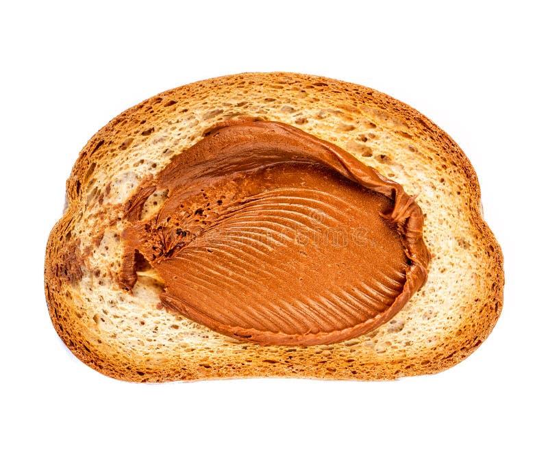 Tostada del pan con la mantequilla de cacahuete cremosa aislada en el fondo blanco Visi?n superior imágenes de archivo libres de regalías
