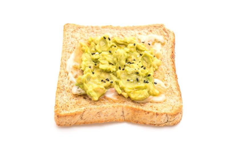 tostada del pan del trigo integral con el aguacate imágenes de archivo libres de regalías