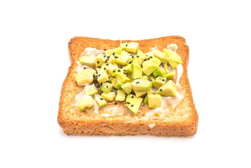 tostada del pan del trigo integral con el aguacate fotografía de archivo libre de regalías