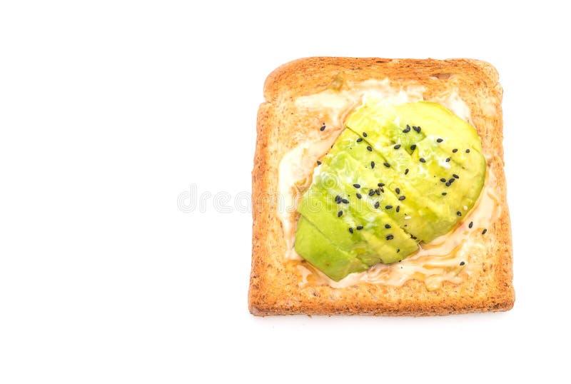 tostada del pan del trigo integral con el aguacate fotos de archivo