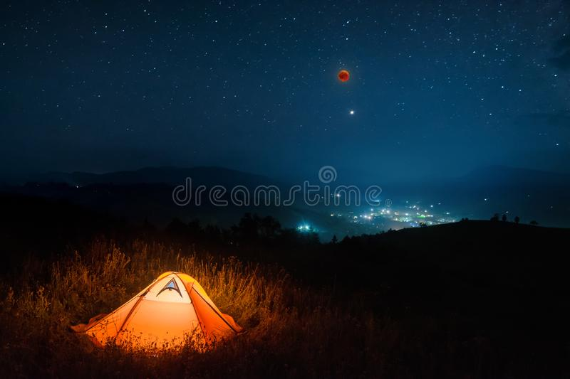 Total moon eclipse in a night starry sky royalty free stock photos