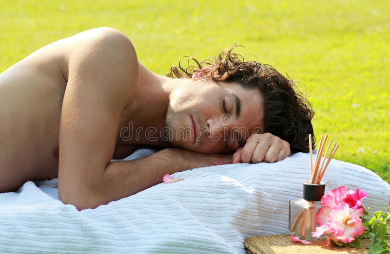 Total relax. Handsome young man sleeping peacefully outdoor . Relax concept royalty free stock photo