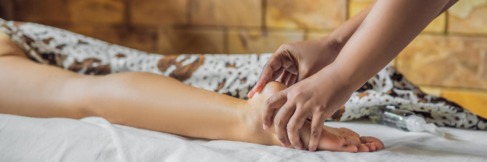 Total relaxation. Beautiful Young Wwoman Get Balinese or Thai Massage BANNER, LONG FORMAT. Total relaxation. Beautiful Young Wwoman Get Balinese or Thai Massage royalty free stock photo