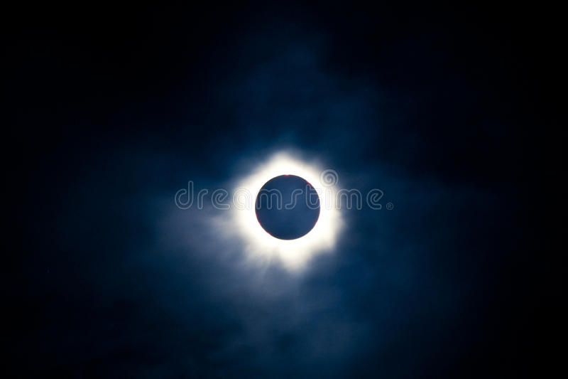 Total solar eclipse with visible corona royalty free stock image