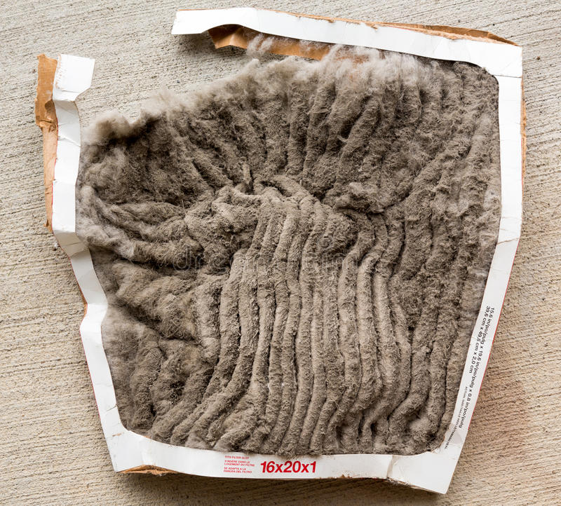 Totally clogged HVAC air conditioning filter. HVAC air conditioning filter clogged with dust and dirt and falling to pieces after not being changed frequently stock photos