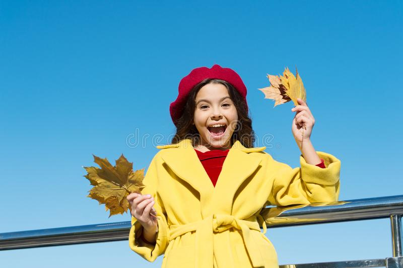 Totally happy. canada. happy small girl. autumn kid fashion. child maple leaf. kid in french beret. leaf fall. favorite. Season. good weather mood. parisian stock photos
