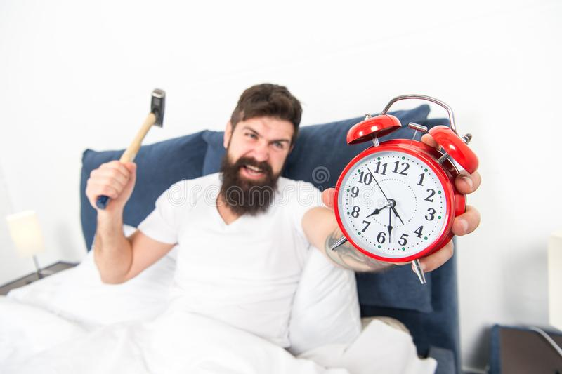 It is totally normal to hate your alarm sound. Hateful schedule. Best alarm clocks for people who hate mornings. Man. Angry hipster hate wake up early stock photo