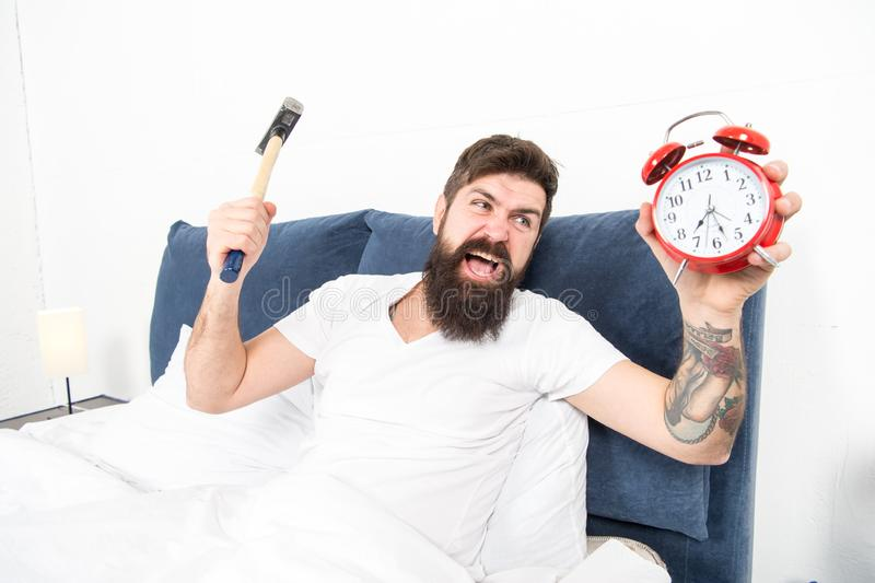 It is totally normal to hate your alarm sound. Hateful schedule. Best alarm clocks for people who hate mornings. Man. Bearded hipster hate wake up early stock photos