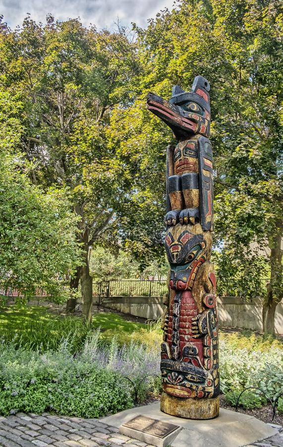 Kwakiutl Totem in the Confederation Park Ottawa. This totem pole is located on Slater Street, in Ottawa, Ontario, Canada at the edge of Confederation Park. It is stock images
