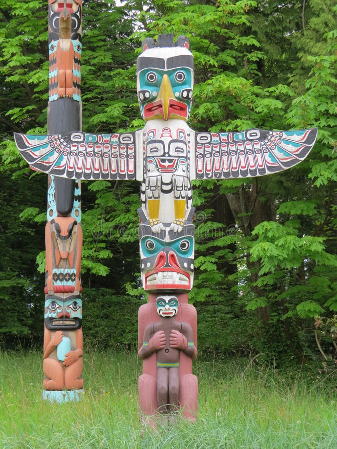 Totem Pole. The Totem poles in Stanley Park, Vancouver are a major tourist attraction. They are copies made for display (the originals are kept in a Canadian royalty free stock photo