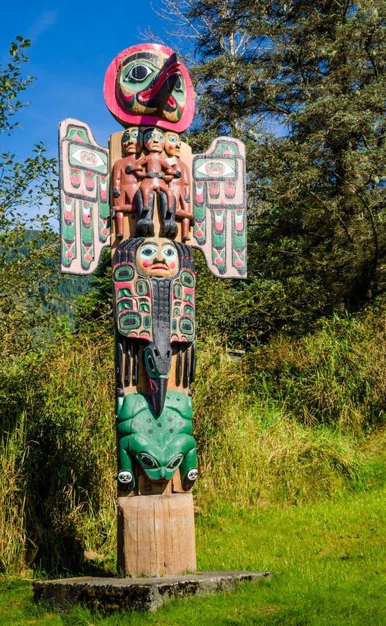 Totem pole in the Saxman Native Village in Ketchikan. KETCHIKAN, ALASKA SEPTEMBER 12, 2016 The totem poles in the Saxman Native Village is the largest collection royalty free stock photo