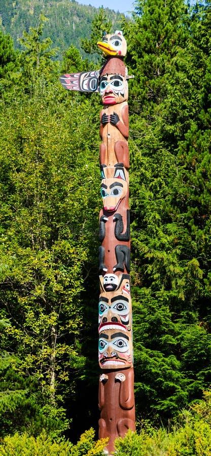 Totem pole in the Saxman Native Village in Ketchikan. KETCHIKAN, ALASKA SEPTEMBER 12, 2016 The totem poles in the Saxman Native Village is the largest collection stock image
