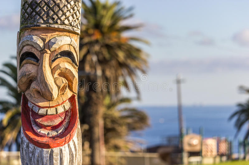 Totem Pole. Smiling totem pole out in Long Beach, California stock image