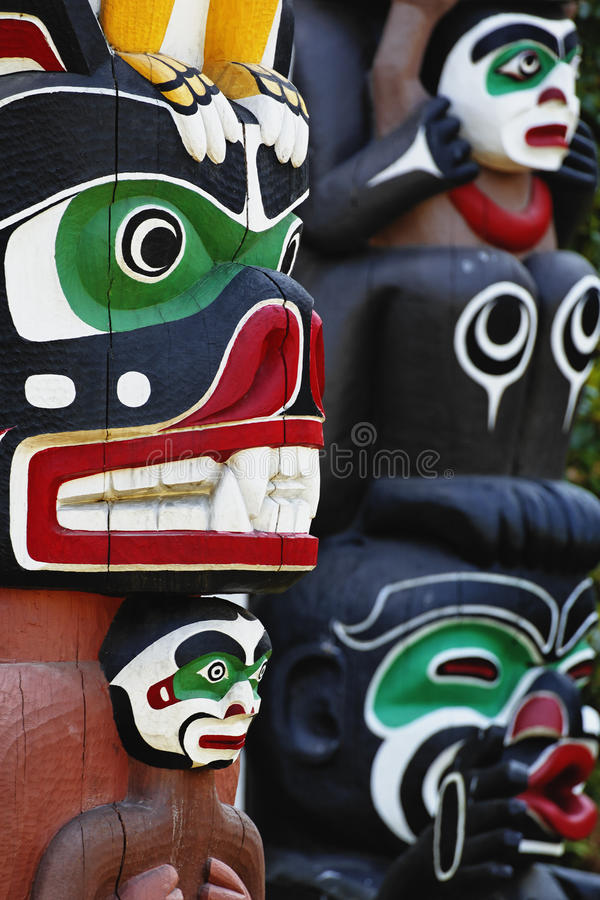 Totem poles. Partial view of Ga'akstalas and Sky chief totem poles. Stanley Park in Vancouver is home to six totem poles located at Brockton Point. Totem poles stock image