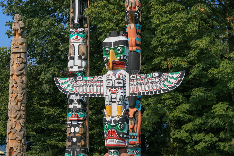 Totem Poles at Brockton Point in Stanley Park, Vancouver, Canada stock photo