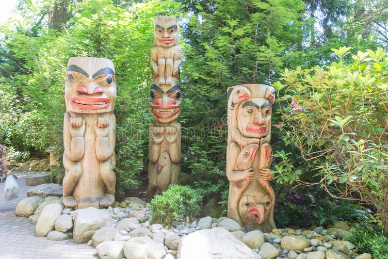 Indian totem poles in Capilano Suspension Bridge in Vancouver, C. Totem poles in Capilano Suspension Bridge, Vancouver, Canada royalty free stock photo