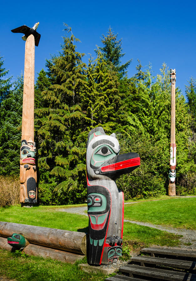Totem poles in the Saxman Native Village in Ketchikan. KETCHIKAN, ALASKA SEPTEMBER 12 2016 The totem poles in the Saxman Native Village is the largest collection royalty free stock image