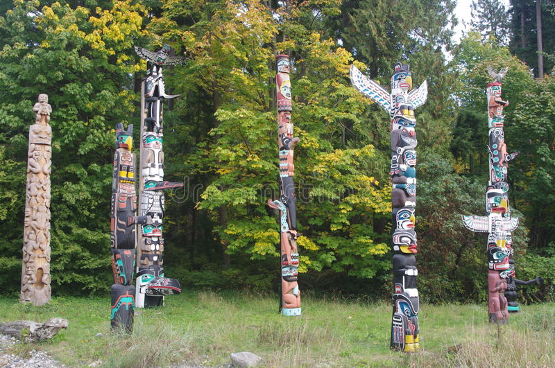 Totem poles in Stanley Park stock photo