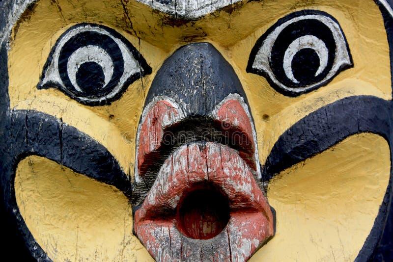 Totempfahl-Gesichts-Nahaufnahme lizenzfreie stockbilder