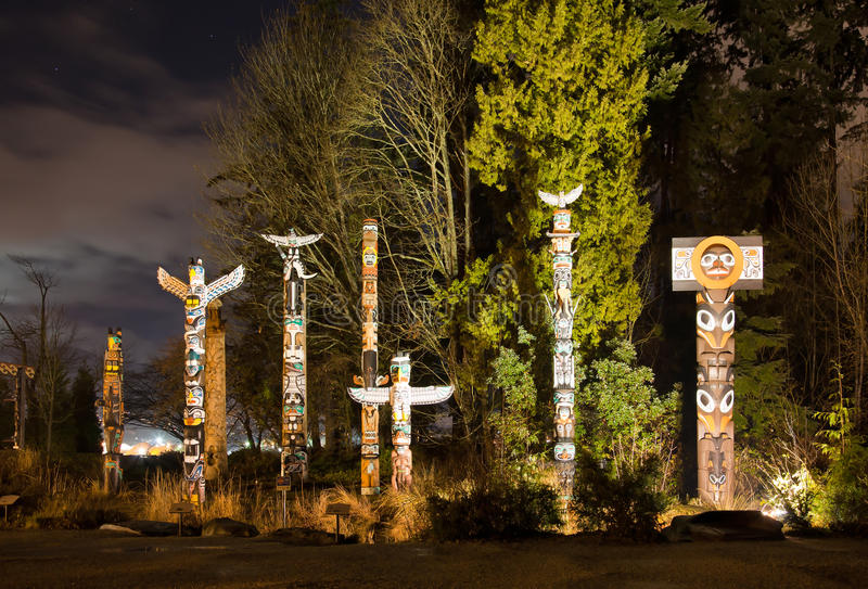 Totems in Stanley Park Vancouver at night royalty free stock image
