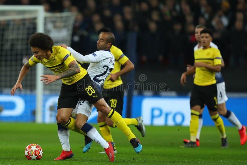 Tottenham Hotspur v Borussia Dortmund - UEFA Champions League Round of 16: First Leg. LONDON, ENGLAND - FEBRUARY 13 2019: Axel Witsel of Dortmund and Lucas of royalty free stock photo