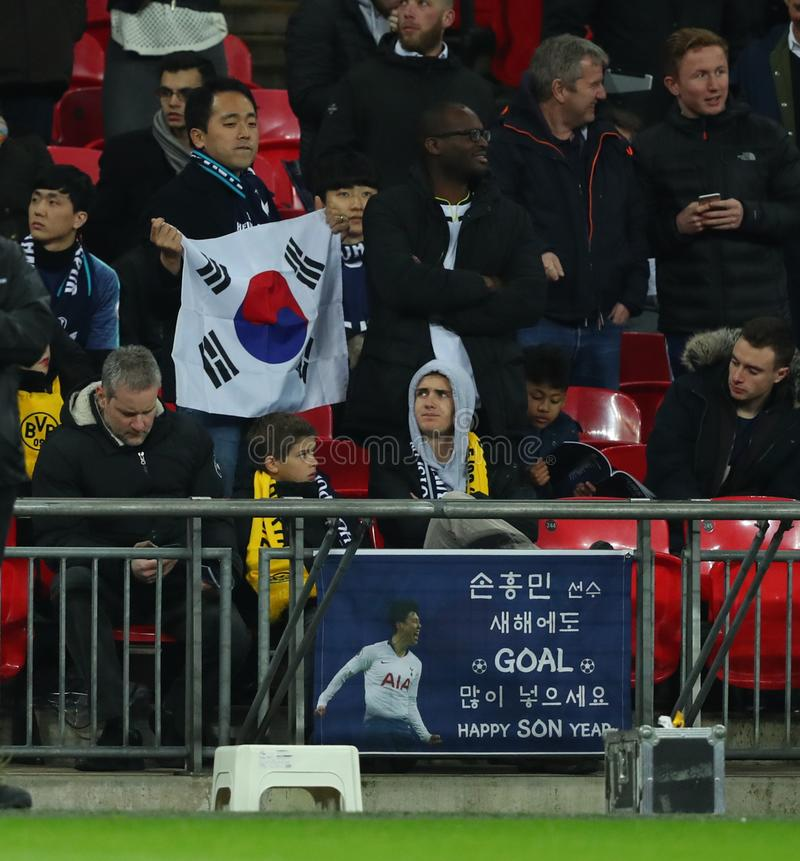 Tottenham Hotspur v Borussia Dortmund - UEFA Champions League Round of 16: First Leg. LONDON, ENGLAND - FEBRUARY 13 2019: A general view of a Korean fan during royalty free stock photo