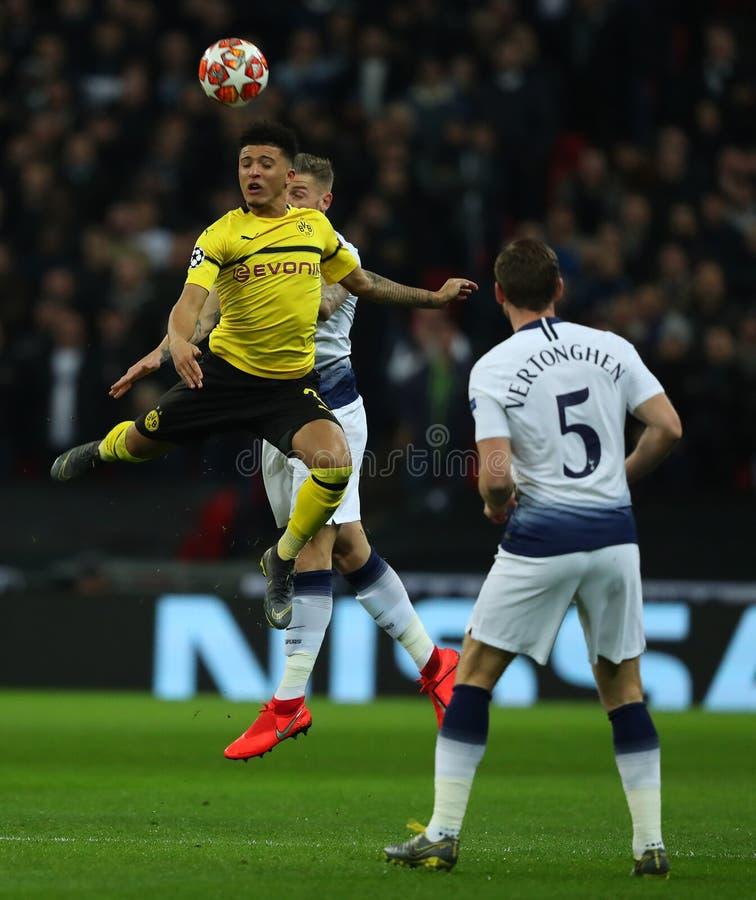 Tottenham Hotspur v Borussia Dortmund - UEFA Champions League Round of 16: First Leg. LONDON, ENGLAND - FEBRUARY 13 2019: Jadon Sancho of Dortmund and Toby royalty free stock image