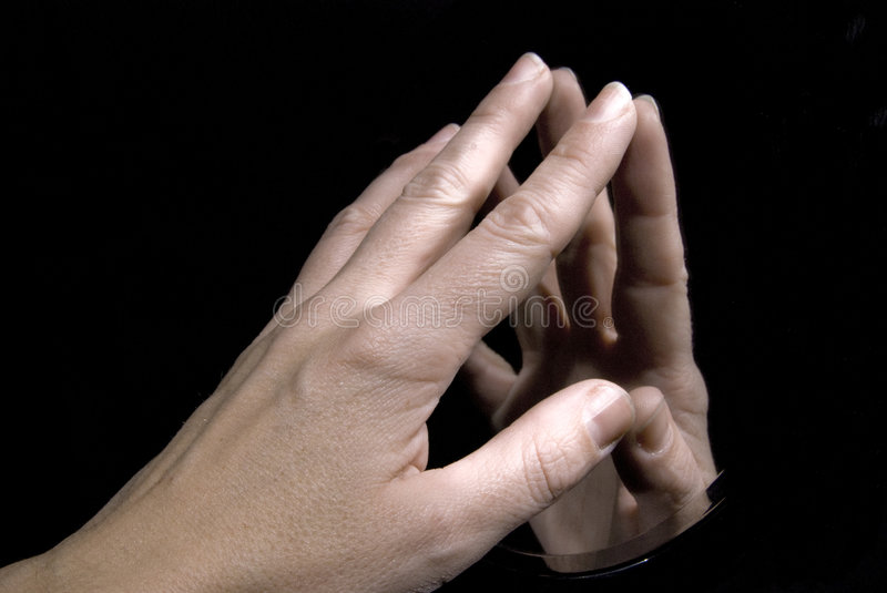 The touch. Womans hand touching itself with a mirror stock images