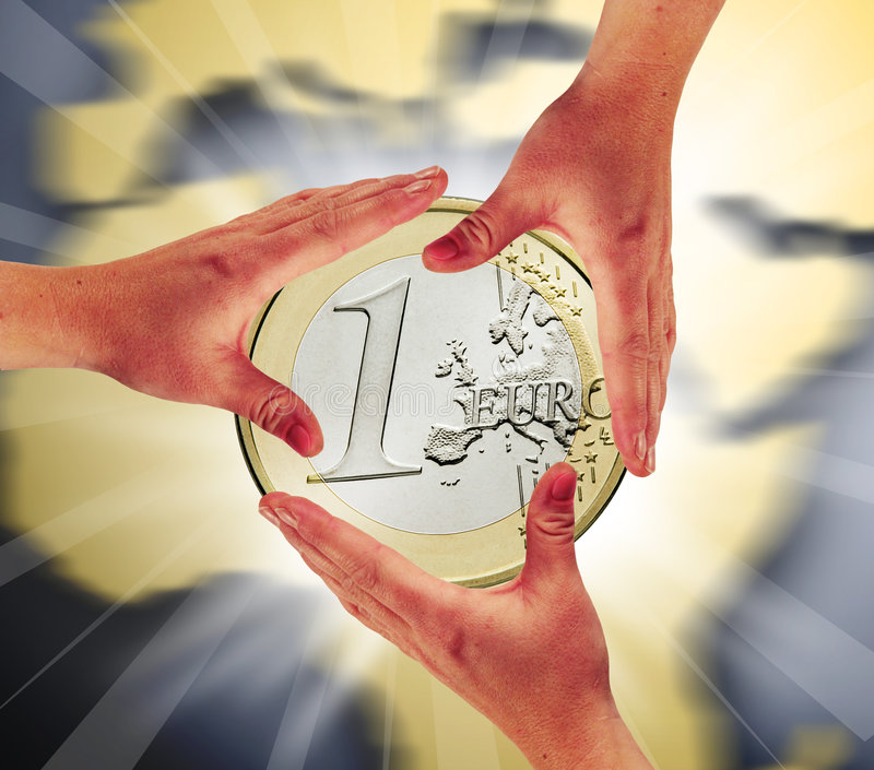 Touch the coin. The hands are touching the one euro coin stock photos