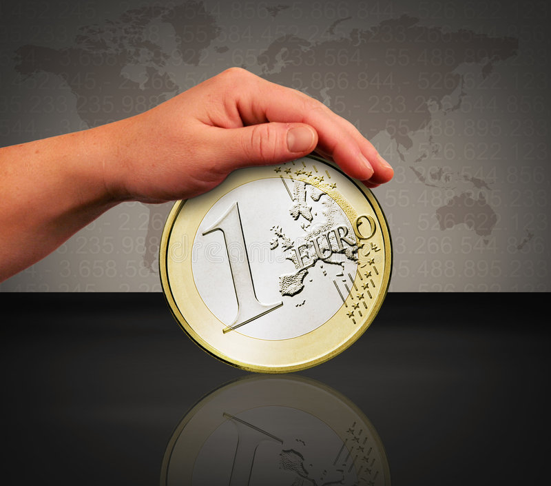 Touch the coin. The hands are touching the one euro coin stock image