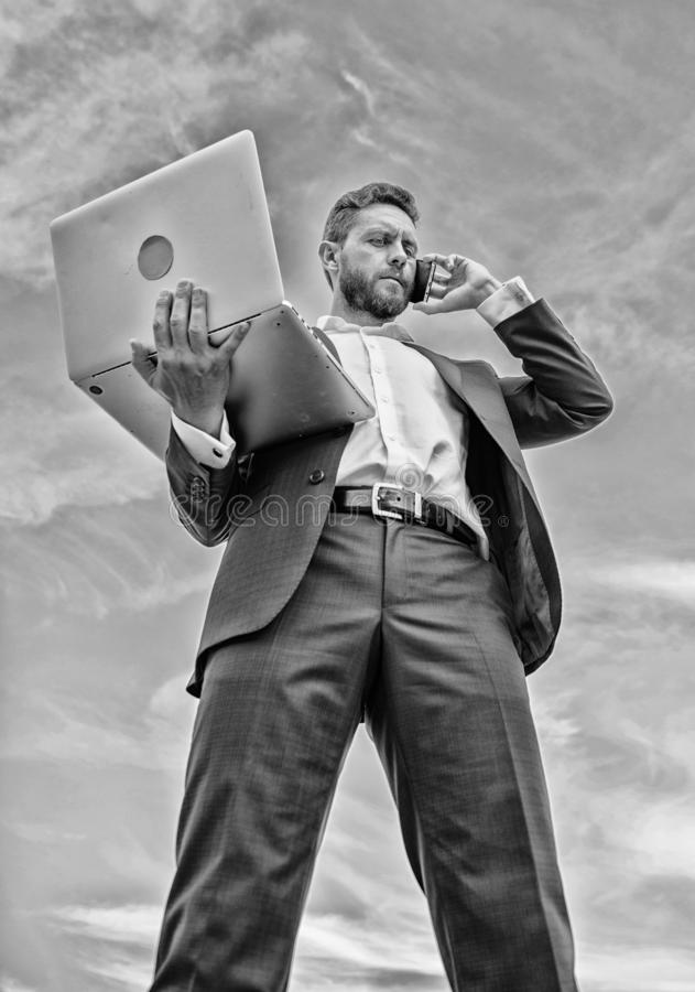 Always in touch. Communicating skill. Guy formal suit modern technology manager entrepreneur answer phone call. Man well stock photography