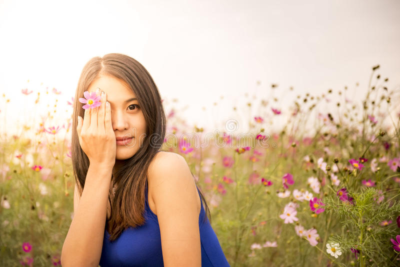 Touch the Flower. A beautiful girl touch the flower stock image