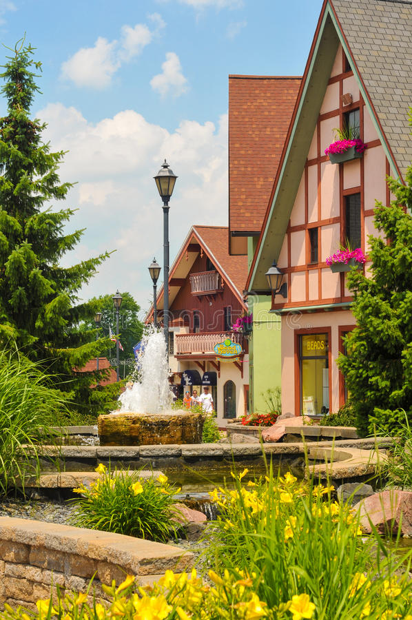 A Touch of Germany. FRANKENMUTH, MI - JUNE 28, 2014: German-style architecture forms the backdrop of River Place, a recently established collection of shops and royalty free stock photos