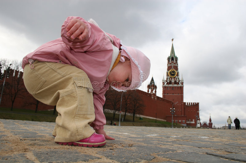 Touch history of Moscow. Baby on Red Square stock photo